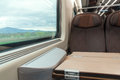 Traveling on high speed train interior of modern with seat and window Stock Photos