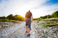 Traveling man rising up for rocky road Royalty Free Stock Image