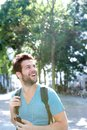 Traveling man smiling with bag and cellphone portrait of a Royalty Free Stock Photography