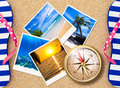 Traveling photos with compass on beach concept Royalty Free Stock Images