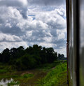 Traveling Thai, rural view from train window Royalty Free Stock Photo