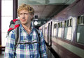 Traveling by train young man with a backpack ready to embark on a journey Stock Photo