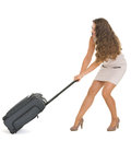 Traveling woman pulling heavy suitcase on wheels Stock Photos