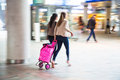Traveling women at the railway station in motion blur Royalty Free Stock Image