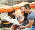 Travell europe young couple tourists with map travel Stock Images