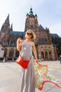 Traveller female on the background of the St. Vitus Cathedral, Prague, Czech Republic