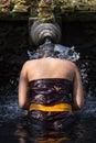 Traveller take a bath at Holy Spring Water Tirta Empul Hindu Temple , Bali Indonesia. Royalty Free Stock Photo
