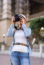 Traveller taking photos female using digital camera in the city Royalty Free Stock Photo