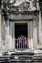The traveller at window of the tower of Angkor wat, Cambodia- Au Royalty Free Stock Photo