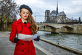 Traveller woman near Notre Dame de Paris in Paris looking at map Royalty Free Stock Photo