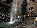 Travellers enjoying near waterfall Royalty Free Stock Image