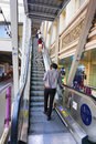 Travellers pass through a bts skytrain station bangkok thailand jan unidentified rail during rush hour in bangkok thailand Stock Photos