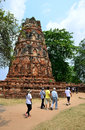 Travellers walking temple ruins wat temple phra mahathat ayutthaya thailand Stock Image