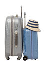 Travelling bags with hat isolated on white background Stock Image