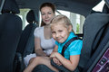 Travelling in car with safety child seat mother and daughter Royalty Free Stock Photo