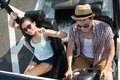 Travelling by car young smiling couple in sunglasses off road vehicle view from above Royalty Free Stock Images