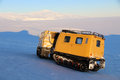Travelling on ross island in antarctica tracked vehicle with mount terror an extinct volcano the distance Stock Photo