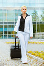Travelling smiling business woman with suitcase Royalty Free Stock Images