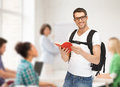 Travelling student with backpack and book travel vacation education concept Royalty Free Stock Image