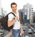 Travelling student with backpack and book travel vacation education concept Royalty Free Stock Images