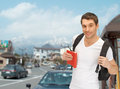Travelling student with backpack and book travel vacation education concept Stock Images