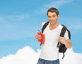 Travelling student with backpack and book travel vacation education concept Stock Image