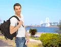 Travelling student with backpack and book travel vacation education concept Stock Photography