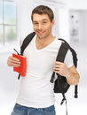 Travelling student bright picture of with backpack and book Stock Images