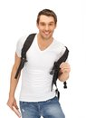 Travelling student bright picture of with backpack and book Royalty Free Stock Photo