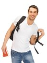 Travelling student bright picture of with backpack and book Stock Photo