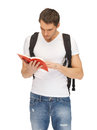 Travelling student bright picture of with backpack and book Royalty Free Stock Photography