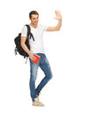 Travelling student bright picture of with backpack and book Royalty Free Stock Images