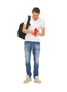 Travelling student bright picture of with backpack and book Royalty Free Stock Photos