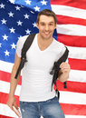 Travelling student bright picture of with backpack and book over american flag Stock Photography