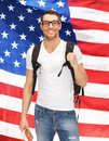 Travelling student bright picture of with backpack and book over american flag Stock Photo