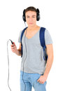 Travelling young man is listening for music on white background Stock Images