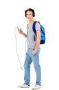 Travelling young man is listening for music on white background Royalty Free Stock Photos