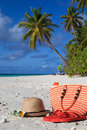 Traw hat, bag, sun glasses and flip flops on  the beach Royalty Free Stock Photo