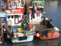 Trawler fleet berthed in harbour Royalty Free Stock Photo