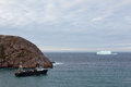 Trawler and iceberg leaving port passing Royalty Free Stock Photos