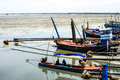 Trawler moored boat near the shore fishing in sea coast Stock Images