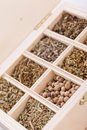 Tray with assorted dried spices and herbs overhead view of a individual divisions displaying for use in a kitchen to season Stock Photo