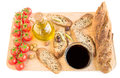 Tray with bread, olives, olive oil, vine, tomatoes on white. Royalty Free Stock Photo