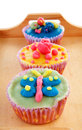 Tray with colorful decorated cupcakes Stock Photography