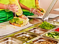 Tray with food on showcase at cafeteria cooked Stock Images