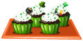 A tray with four chocolate cupcakes illustration of on white background Stock Photography