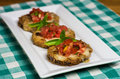 Tray of fresh bruschetta with tomatoes and basil Royalty Free Stock Images