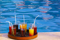 Tray with many drinks on the poolside Royalty Free Stock Photo