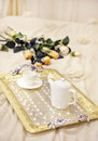Tray with morning coffee in a bed decorated with roses Royalty Free Stock Photography