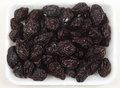 Tray of prunes from above in a supermarket Royalty Free Stock Photography